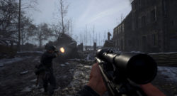 Hell Let Loose Deploys To PS5 and Xbox Series X|S - shooting a rifle in an abandoned village